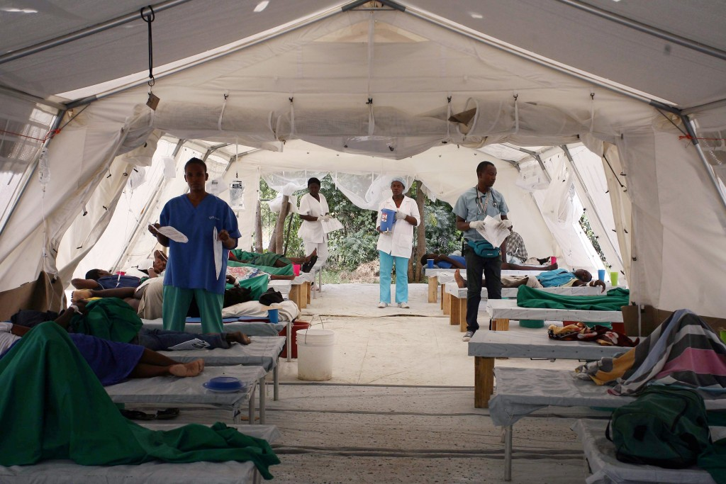 Medcial personnel tend to patients suffering from cholera at the Hospital Bicentenaire run by Doctors Without Borders in Port-au-Prince, Haiti, Dec. 10, 2010.